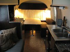 """This gorgeous Airstream looks like a Manhattan apartment.  I prefer the modern look inside, instead of a """"gypsy"""" feel."""
