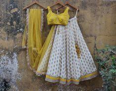 brocade and yellow blouse lehenga White brocade and yellow blouse lehenga Blouse Lehenga, Sabyasachi Lehenga Bridal, Half Saree Lehenga, Lehnga Dress, Indian Lehenga, Brocade Lehenga, Banarasi Lehenga, Lehenga Gown, Sharara