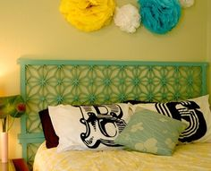 This could easily work as a headboard, take a fireplace screen and paint to the color you want! Affordable fix for your bedroom!