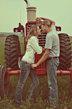 engagement photo with tractor www.bmwphotographyproductions.zenfolio.com