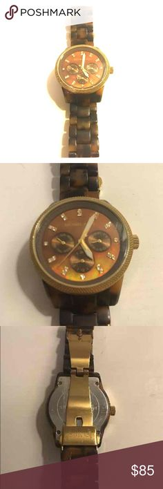 Michael Kors MK5038 Tortoise Watch Michael Kors Chronological watch. Wristband is tortoise shell with all original hardware included. Gold face with crystal clock marks. Slight scratch in upper right; barely visible (picture #2) Michael Kors Accessories Watches
