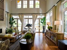 Absolutely beautiful interior! Love the wood floors, color choices, and lush green plants. Gives the room a relaxing tropical, but fun tiki vibe!