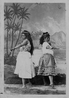 Two hula dancers.