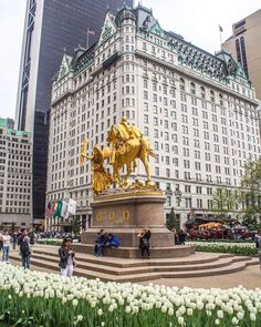 Plaza Hotel New York City after our tacky  Idiot purchased it ...at one time this statue was black with hues of green patina can you say gorgeous, so after they refinished it for 8 months you couldn't look at it for fear of a blinding headache
