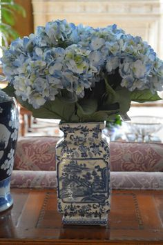 The Enchanted Home -put hyacinths above window in kitchen in navy blue & white bowls