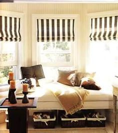 bench in bay window w/ baskets underneath - alternative to built in, and let's air vent on floor do it's job.