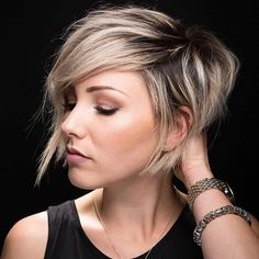 10 Latest Pixie Haircut Designs for Women – Super-stylish Makeovers Take a look at these trendy makeovers, showcasing the latest pixie haircut designs for women of all ages! I challenge anyone to browse through . Short Hair Styles For Round Faces, Short Hair With Layers, Hairstyles For Round Faces, Long Hair Styles, Pixie Haircut For Round Faces, Color On Short Hair, Long Pixie Cut With Bangs, Pixie Cut With Long Bangs, Long Side Bangs