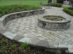 Patio pavers and a fire pit.  You can find pavers in the Habitat ReStore.