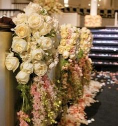 Every other chair down the aisle way... floral wedding aisle: Reds, Oranges, Purples