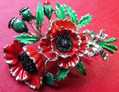 Vintage EXQUISITE Enamel POPPY Flower Birthday Series Brooch Pin Badge August Beautiful Condition with minor enamel loss. Marked on back Exquisite a... #black #flowers #green #leaves #poppy #red #silver