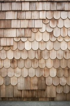 """This Minimal Japanese Getaway Was Built for Surfing - Photo 3 of 7 - A mix of red cedar shingles and scales make of the exterior. The design is intended to be a """"layered flow"""" that will age over time with the family, blending into the surrounding nature."""