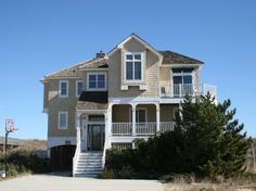 The Caribbean Queen in Nags Head on the Outer Banks. 5 bedrooms, hot tub. Located near milepost 15 on the oceanfront. Village Realty manages this home. Property ID is BH4N