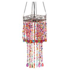 Adorned with vibrant strings of cascading multicolor beads, this eye-catching lantern casts an eye-catching glow over your decor.  P...