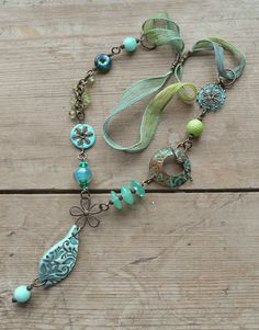 Handmade Lampwork, Brass and Silk Necklace in turquoise and greens.