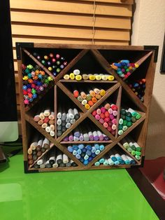 Copic marker storage. Wine rack, foam board, double sided tape, and wood print scrap book paper to cover the foam board dividers to match the wood look.