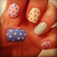 Pastel nails don't always have to be simple, add dots for effect.