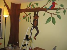 A jungle-themed mural that I painted for my sister's nursery