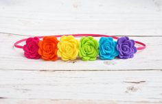 Handmade+roses+in+rainbow+shades+crafted+from+high+quality+wool-blend+felt,+placed+on+hot+pink+skinny+elastic+in+your+choice+of+size.+Roses+measure+approx.+1+inch+wide+each.+