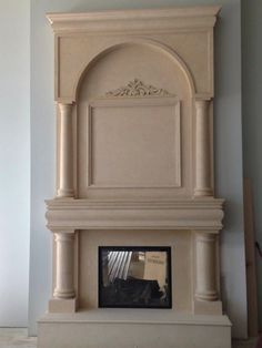 Omega Mantles of Stone, Mantle & Overmantle with Town & Country Gas Fireplace all by Rettinger Fireplace Systems.