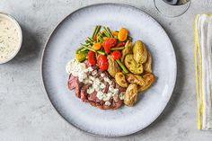 Creamy Bearnaise Strip Steak with Fingerling Potatoes, Sauteed Green Beans, and Tomatoes
