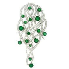 Designer pendant in sleek diamonds embellished with the dashes of emerald. #jewelry