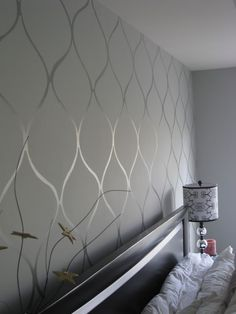 Stenciling glossy paint over the same color in a different finish makes for a very subtle, sophisticated, and cozy wall