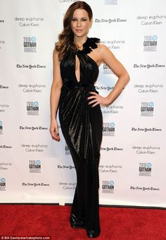 Glitz and glamour: The 43-year-old looked younger than her years in a slinky black Marchesa gown which clung to her slim figure in all the right places
