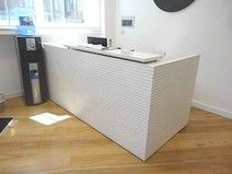 A magnificent used white ribbed reception desk with corian top shelf. Will most definitely enhance any tired looking reception area + Vat Corian Top, Used Office Furniture, Reception Areas, Tired, Shelf, Desk, Home, Shelving, Desktop