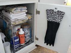 Stow dishwashing gloves below the sink by clipping them to the door. Boots can be stored the same way, with a clip holding the middle part of each leg together, then using one end of the binder clip to hook to the closet wall or door--no more droopy boots
