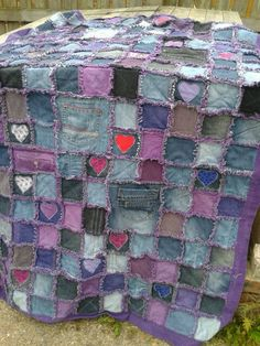 "My very first quilt. An ""upcycled"" Denim Rag Quilt made from old jeans and a purple dyed flanelette sheet. The appliqued hearts are from old t-shirts."