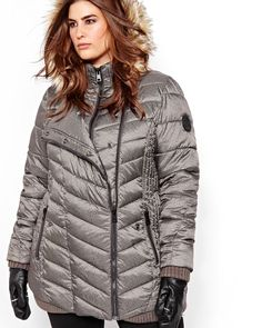 Take on the cool weather with this warm plus size jacket from Livik. The perfect cut molds to your curves for a super sexy look. Asymmetrical zipper, trendy faux fur on the hood. mock neck, zippered pockets. 32 inch length.