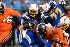 Broncos vs. Chargers:   October 13, 2016  -  21-13, Chargers   -       San Diego Chargers running back Melvin Gordon #28 gaining yards against the Denver Broncos at Qualcomm Stadium, San Diego, CA October 13, 2016.