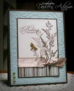 Stamps: Watercolor Trio, Garden Silhouettes   Paper: Chocolate Chip, Soft Sky, Basic Grey DP, Soft White   Ink: Chocolate Chip   Accessories: Satin ribbon, dragonfly and round brads, CB embossing folder