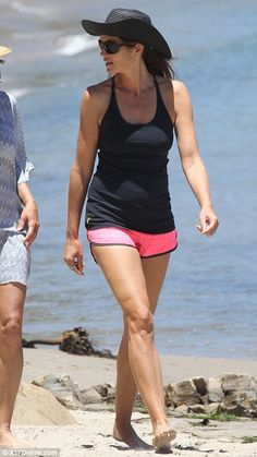I have friends in their 40's who have worked out/ate right- have great legs... we don't need to go to heck-in-a hand-basket just because we add some years! :) (Afternoon stroll: Cindy Crawford chatted to a friend as she walked by the shore)