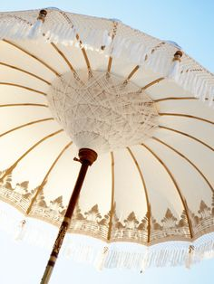 Sun parasol $249. Oh, wow! It looks like a chandelier under a Fortuny lamp. Perfect.