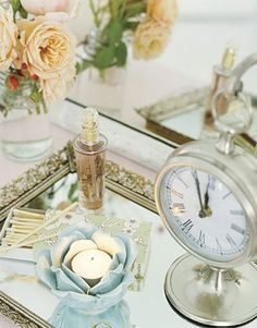 pretty candle, clock, on mirrored tray