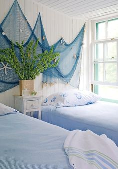 Decorative Fish Net as Wall Decor: http://www.completely-coastal.com/2011/02/chic-bedrooms-nautical-design-ideas.html Fish Net is draped along the wall instead of a headboard.