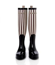 The iconic Henri Bendel brown and white stripes for the uptown mom.  Henri Bendel, $98.00. #rainboots  See more rain boots at  easystyleformoms.com.