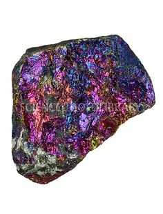 Chalcopyrite. Copper iron sulfide mineral. Stone with multicoloured reflective shiny surface colours.