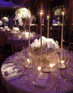 1.looks like orchids on the bottom, roses on top, hydrangeas in between and amongst the roses. i love the way this looks. centerpieces and table settings.