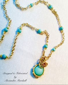 "Love this wire wrapped and 18K Gold overlay turquoise pendant by Alexandra Marshall. Enjoy 18"" - 24"" long on its own or as a layered companion to a longer piece. $89. #N2277 Double click photo to order."