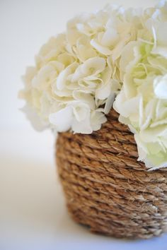 This simple rope vase is a chic solution to spicing up an old glass vase.