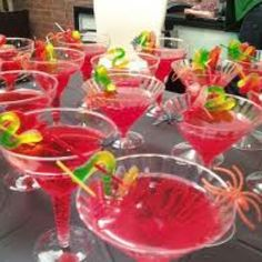 Cherryade with gummy worms etc in a plastic martini glass. Perfect for a teens Halloween party!