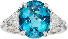 Paraiba Tourmaline, Diamond, Platinum Ring, Tiffany & Co. The ring features an oval-shaped tourmaline measuring 11.84 x 9.54 x 6.98 mm and weighing 5.39 carats, enhanced by triangle-cut diamonds weighing a total of approximately 1.00 carat, set in platinum, marked Tiffany & Co. Gross weight 8.49 grams. Size: 6 (sizeable)