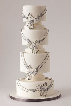 Sketches of bows and ribbons on fondant wedding cake.  I love the sketchy look!