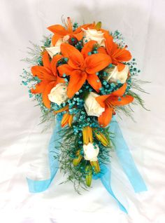 Fall Wedding Cascade- Style Bride's Bouquet - Orange lilies, white roses, and teal babies breath.  www,gracisflowers.com