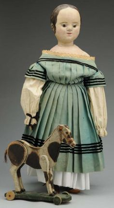 Izannah Walker Doll with painted wood horse on wheels, Morphy Auction December 4th 2012