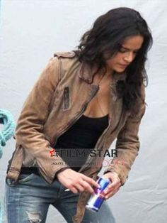 The Letty Ortiz distresses brown women leather jacket worn by Michelle Rodriguez in the recent blockbuster movie, Fast and Furious 7. It's an amazing women's outfit that comes with Free global shipping and return/exchange policy. Order yours now, great for clubs, shopping and winter!