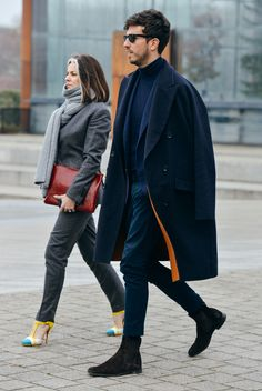 How I love a flash of colour from a monotone look! Double sided cashmere coat! Me want!!!! Source: Tommy Ton in Paris: Street Style at the Fall '15 Men's Shows - Gallery - Style.com