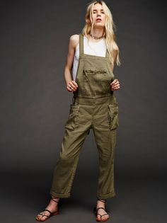 Lost Boys One Piece    In a linen blend, these lightweight overalls have thick crossed back straps with an adjustable tie at the hips that give a relaxed, slouchy fit. Large side pockets and front zip pocket add extra menswear inspired detail. Slightly rolled hem.
